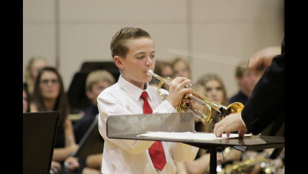 Quinn Buss performs a trumpet solo during the seventh- and eighth-grade concert appearance.