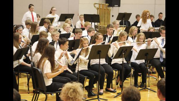 "Seventh- and eighth-grade students perform ""Ballad for Trumpet,"" which included a trumpet solo by Quinn Buss"