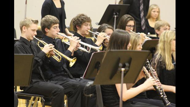 """High school trumpet players (from left) Joe Guy, Brandon Winter and Mitchell Muller play their parts in the song, """"The Machine Awakes."""""""