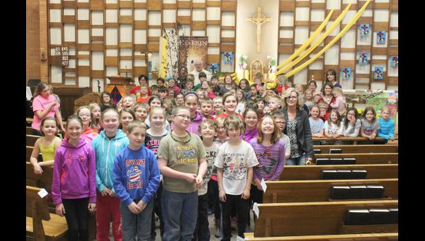 The Wednesday after-school students at St. Catherine gathered for a group photo after the blessing of the tree.