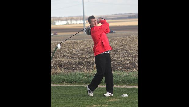 Senior Seth Miller completes a drive on the No. 8 tee box during a home match with Marshall April 21.