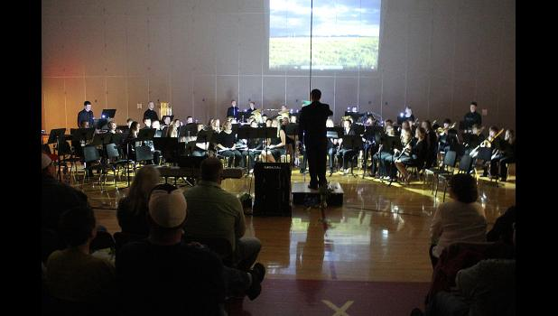 "The high school band concludes Friday's concert with ""Lightning Field,"" which was accompanied by crashing percussion and a slideshow featuring lightning strikes."