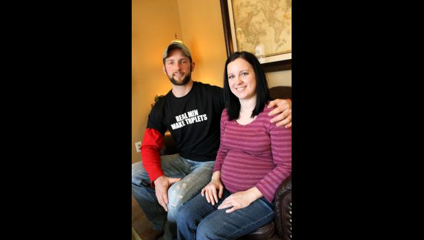 "Anthony and Megan Boyenga are expecting triplets. As Anthony's T-shirt reads, ""Real Men Make Triplets."""