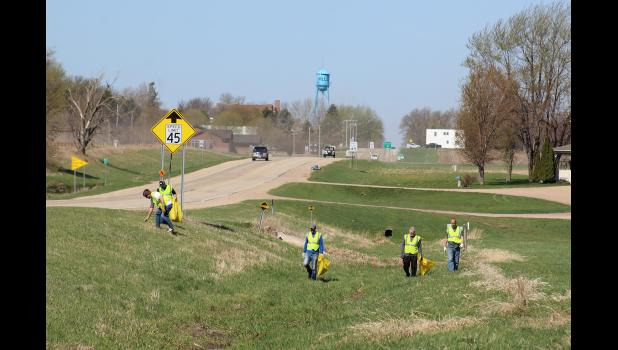 Cleaning the north side of Hwy 270, east of Hills, are (from left) Dan Ellingson (bending over), Chris Louwagie, Kale Wiertzema, Jason Blosmo and Rex Metzger.
