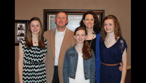 Rob and Gina Newman became parents of triplets almost 16 years ago. Pictured (front, left) are daughters Kelly, Brianna and Jamie.