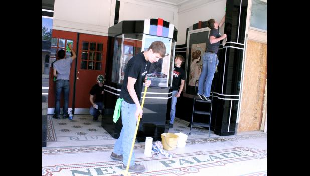 Luverne High School seniors (from left) Omar Martinez Pizano, Dalton Wenzel, Brody VanderSteen, Brady Hudson and Drew Weis clean, polish and sweep the front of the Palace Theatre on Main Street Luverne.