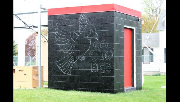 Luverne HIgh School Senior Spencer Schacht chalked out the Cardinal design on the equipment shed.