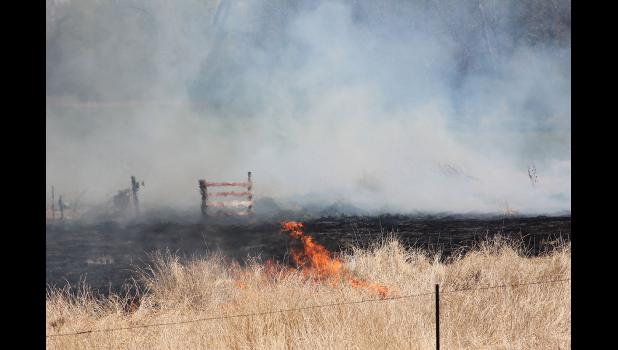 The Luverne Fire Department works to contain a fire west of Luverne Thursday, April 30, near the Assembly of God Church.