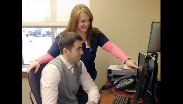 Dr. Zach Nolz and registered nurse Casey Westphal use the telehealth system to see Mary Jane Brown residents electronically from Sanford Luverne.
