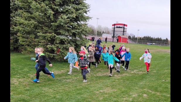 Kindergartners in Monica Edstrom's and Jessica Van Batavia's classrooms race off the starting line May 5 during the annual running of the Cardinal Dash, a fun run fundraiser organized annually by Parent Partners In Education. The students complete a half-mile or a two-mile run, depending on grade level.