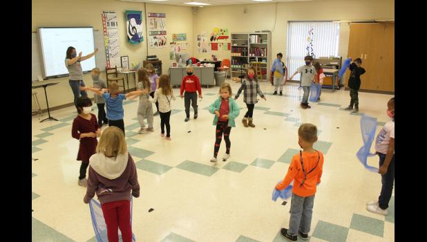 "Kindergarten students perform the ""Carnival of the Animals"" Friday morning with Luverne Elementary School music instructor Morgan Van Holland (back, far left). A video featuring each classroom will be released this week in lieu of a public concert."