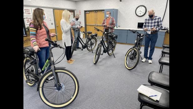 Luverne Economic Development Authority Director Holly Sammons (second from left) leads LEDA members on a test drive of the new e-bikes rental program during their Monday morning meeting in Luverne City Hall Council Chambers. From left are Sherri Thompson, Sammons, Kevin Aaker, Mayor Pat Baustian and Mike Engesser.