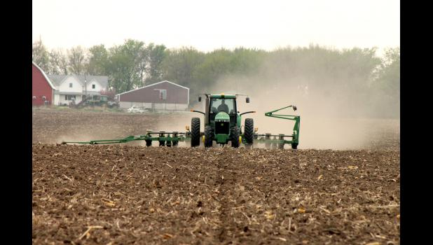 Danny Roskamp kicks up dust while planting soybeans northeast of Hardwick last week. Due to the dry soil conditions, farmers across the state are reaching the fastest planting on record in 30 years.
