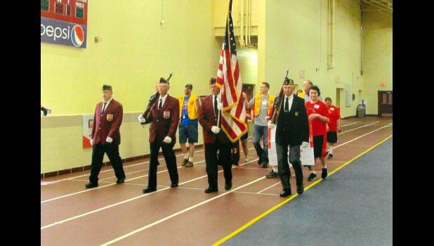 Members of the Luverne American Legion and VFW led the procession of coaches and athletes in the opening ceremonies of the Area 8 Special Olympics Track and Field Meet in Redwood Falls recently. Pictured in front (from left) are Buck Underwood, Gary Hassebroek, Jerry Hoff and Mel Hamann.
