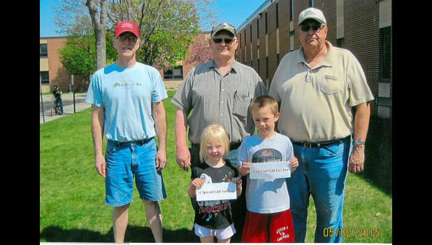 This year's bike winners are Katie Enninga (left) and Keagen Jessen. They're pictured with volunteers Mike Schacht, Keith Aanenson and Cliff Boom.
