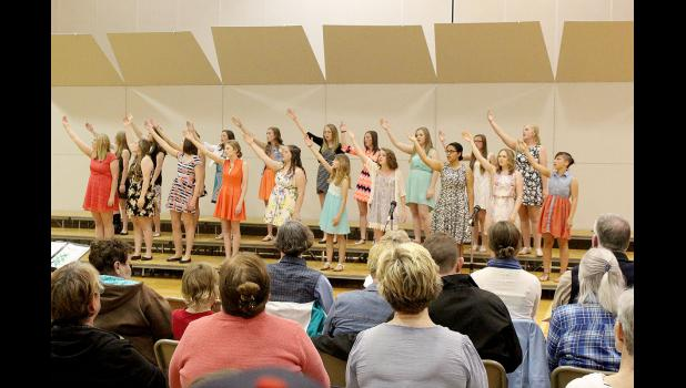 "The ninth-grade girls choir performs ""Songs of a Disney Princess,"" including ""A Dream is a Wish Your Heart Makes"" and ""Whole New World."""