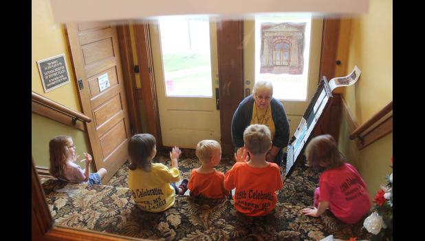 Carolynn Baustian of Jasper prepares her day care group for departure for home in the lobby of the Carnegie Cultural Center in Luverne.