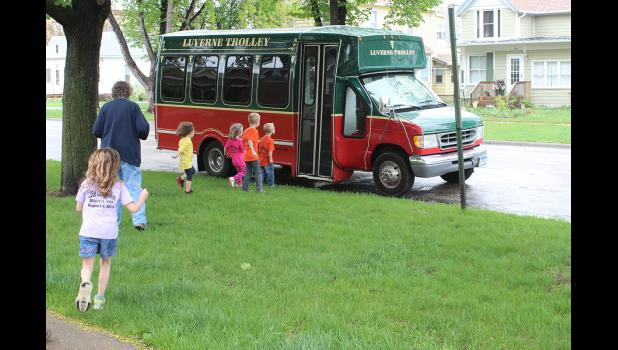 Carolynn Baustian's day care group boards the Luverne trolley after their trip to the Carnegie Cultural Center on Thursday, May 7.