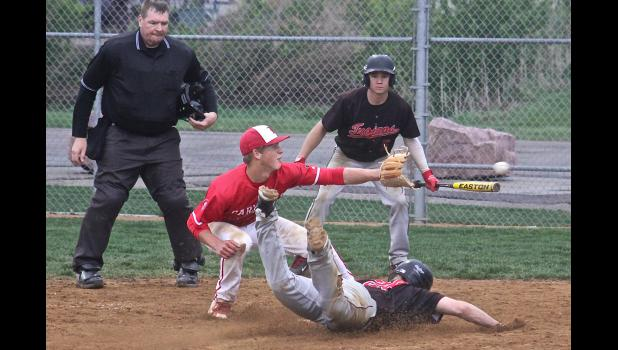 Luverne senior Connor Crabtree covers home plate as a Worthington runner crosses the dish during Thursday's game at Redbird Field.