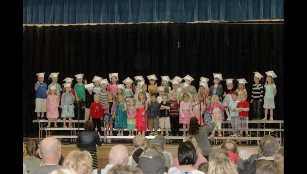 "Little Pates Academy preschoolers sang songs including ""Take Me Out To The Ballgame,"" ""Five Little Ducks"" and ""Five Little Monkeys"" at their graduation ceremony at the Hills-Beaver Creek Elementary School Thursday, May 7.  A total of 31 students graduated from the academy."