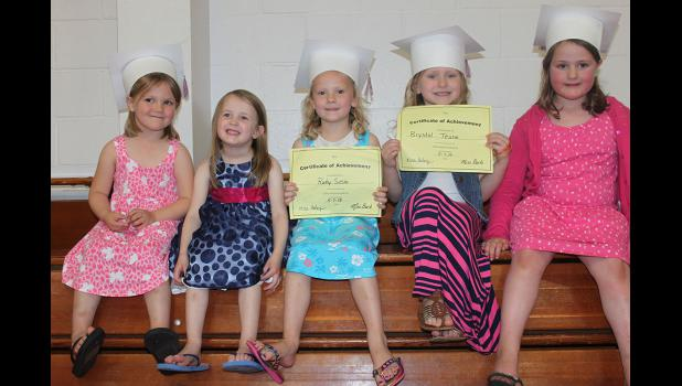 Chloe Susie (left), Audrey Rentschler, Ruby Susie, Brystol Teune and Ella Rheault pose after participating in the Little Pates spring concert at Hills-Beaver Creek Elementary School Thursday, May 7.