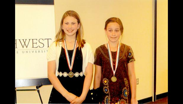 Lauren Tatge, left, and Tyrae Goodface were invited to Southwest Minnesota State University for their wringing entires in the Creating Spaces Writing Contest.