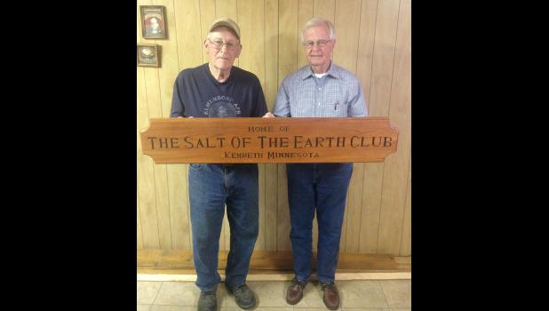 Brothers Bud (left) and Don Rust show the sign Don made in his wood shop for the Kenneth Community Center.