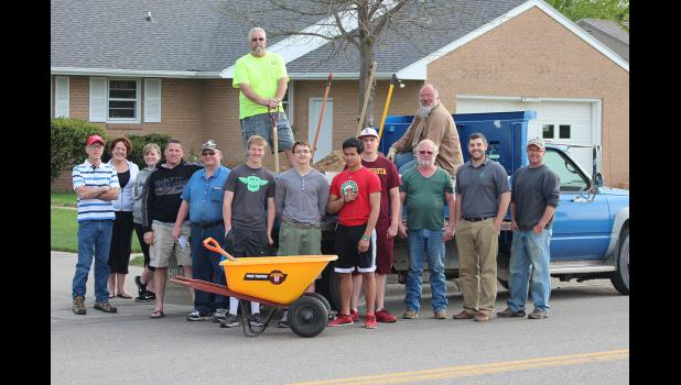 Pictured are (on the ground, from left) Mike Schacht, Carol Morgan, Allison Zollner, Glenn Oeltjenbruns, Keith Aanenson, Jim Erickson, Daniel Tofteland. Toby Sengvongxay, Nathan Nekali, Dale Reverts, Codie Zeutenhorst, Travis Pierce, (in pickup bed) Sam Berghorst (left) and Dan Steensma.