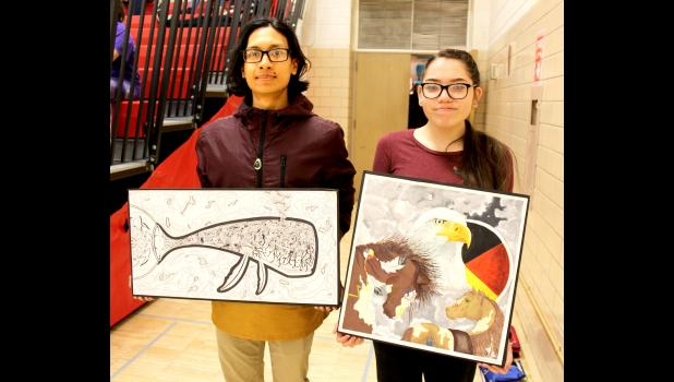 Art students Joel Ortiz (left) and Talitha Andersen hold the artwork that earned them the Judges' Choice Spotlight on the Arts award at the Region 3A Minnesota State High School League Visual Arts Competition April 26. As Spotlight winners they were invited to display their creations Saturday at the Perpich Center for the Arts in Golden Valley with other regional Spotlight winners.