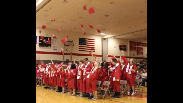 Mortarboards flew Sunday afternoon signifying the end of Luverne High School's Class of 2015 commencement exercises Sunday in the elementary gymnasium.