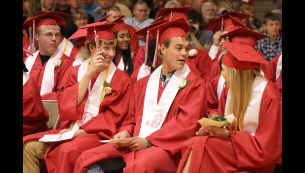 Wyatt Hoag (far left) Jake Aukes, Colton Arends and Blair Altman look around the Luverne Elementary School gymnasium as a fire alarm blares during Sunday's Class of 2015 commencement exercises Sunday.
