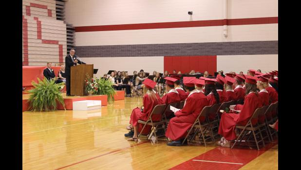 Retiring Superintendent of Schools Gary Fisher addresses the Class of 2015.
