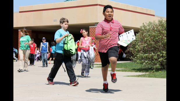 Recently graduated fifth-grader Jesse Gutierrez shows his enthusiasm as he leaves Luverne Elementary School Wednesday, May 13, the last day of the 2014-15 school year.