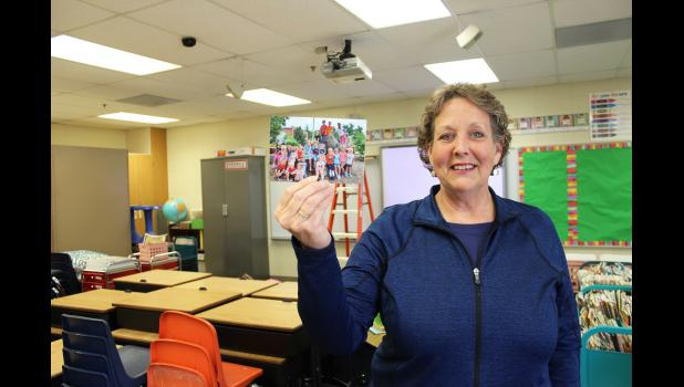 After 40 years in the classroom, Luverne Elementary teacher Sue Hup announced that the 2019-20 school year would be her last. Hup holds a picture of her current first-graders, whom she's been teaching virtually since March.