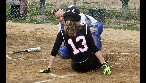 Adrian Area catcher Brooke Grussing attempts to tab out a Red Rock Central-Westbrook-Walnut Grove runner at home plate during Friday's tournament game in Ellsworth.