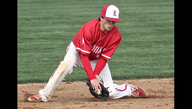 Luverne shortstop Connor Sandbulte scoops up a bounding ball during Friday's 4-3 home loss to Buffalo.