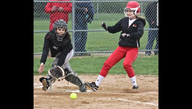 Brianna Jonason scores a third-inning run during Monday's 13-3 home win over Worthington.