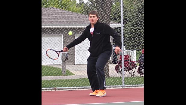Cade VerSteeg teamed up with Mark Robinson to win a pair of doubles matches to help the Cardinal tennis team clinch the section title Tuesday in Redwood Falls.