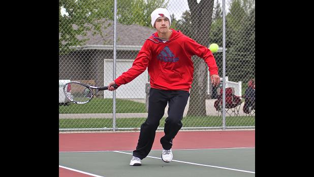 Mark Robinson strikes a forehand during Monday's section tournament win against MACCRAY.