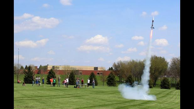 Students in Richard Owen's Flex Time class on rocketry spent Wednesday afternoon, May 15, launching their creations, including this large rocket that required a Notice to Airmen requirement to the local airport because of the height the rocket could reach.