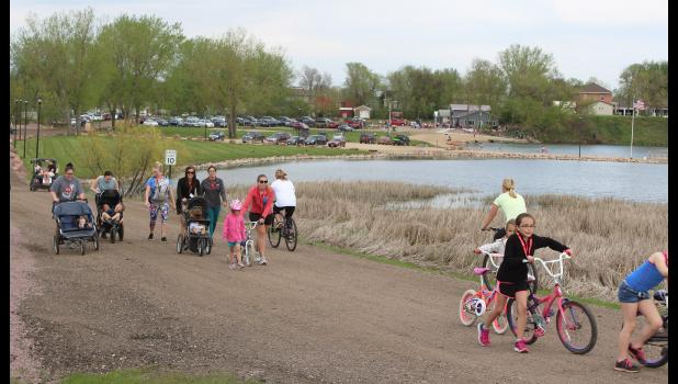 Participants were encouraged to enjoy The Loop by riding bikes, walking or accepting a special opportunity to ride on chauffeured golf carts. A children's scavenger hunt encouraged about 120 kids to dismount their bikes and enjoy three of the pocket parks and nature areas located along The Loop.