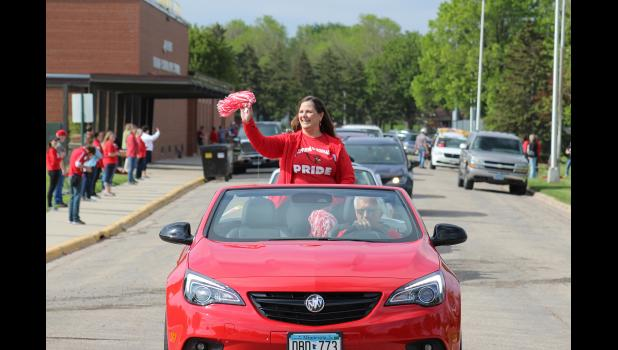 Retiring Luverne Community Education Director Karen Willers leads the procession through the Luverne Public Schools parking lots. She retires after spending 41 years in the district.