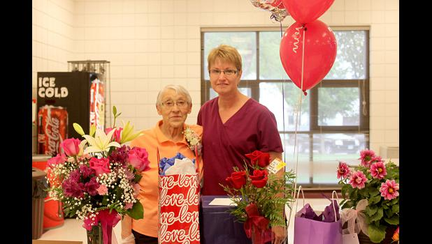 Alice Brandt (left) was honored Monday, May 18, during Lift-Off Ceremonies at Hills-Beaver Creek Elementary School for her 39 years of service as a custodian. She is pictured with co-worker Cheryl Hup.