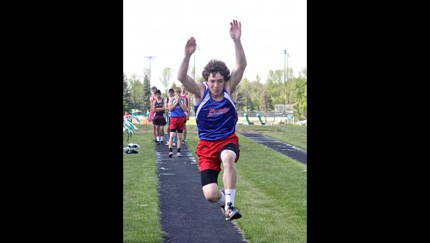 H-BC's Cooper Vaughn, pictured during triple jump competition, qualified for section competition as a member of the 400- and 800-meter relays during the sub-section meet in Pipestone Thursday.