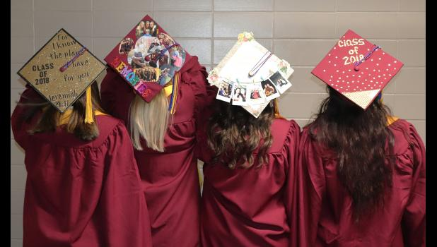 Each year EHS seniors are given the option to decorate their mortarboards, which the four graduating girls (from right) Madyson Domeyer, Devin Dreesen, Kristi Kooiker and McKenna Hinrichs took advantage of and completed four unique cap designs.