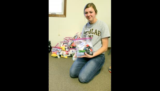Ryleigh Beers holds one of the 170 Blessing Kits, a project she was able to organize, fundraise and assemble for three organizations.