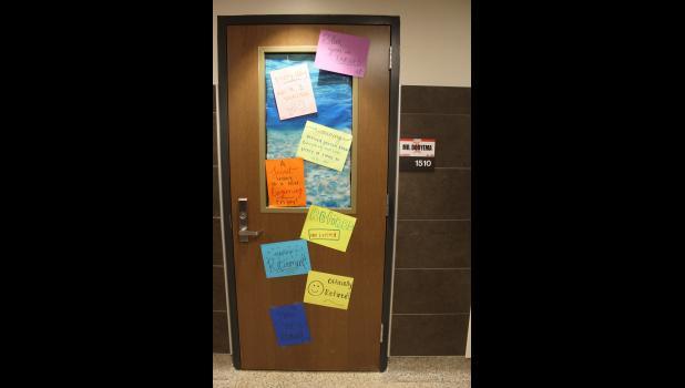 """Words of """"retirement"""" encouragement were taped to Dooyema's door on his last day of school."""