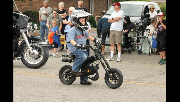 Michael Behr rides his motorcycle in the Buffalo Days Parade Saturday, June 6.