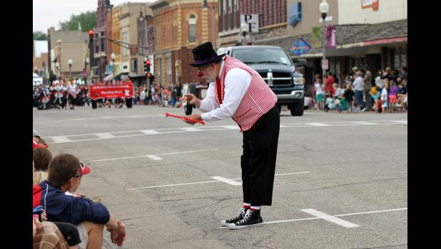 """Buster,"" with El Riad Shrine Clowns, entertains children along the parade route Saturday morning, June 6, at the 31st Annual Buffalo Days in downtown Luverne. There were 78 parade entries."