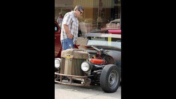 Tim Ollerich of Heron Lake admires the 1926 Dodge uniquely constructed by Luverne's Keith Schmuck at the Cruise-In in downtown Luverne Friday night, June 5. The event kicked off the 31st Annual Buffalo Days Celebration.